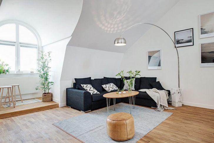Scandinavian Duplex Design Living Area with Elegant Lighting