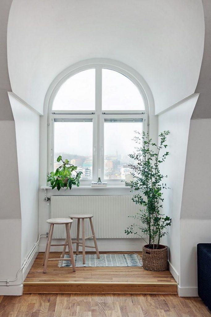 Scandinavian Duplex Design Living Area with Room Heater