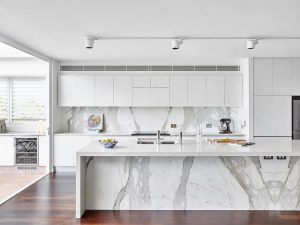 grey and white kitchen Marble and White Island Cherry Wood Floors White Cabinets 29